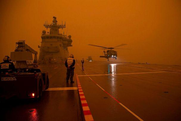 PHOTO: A Royal Australian Navy helicopter departs HMAS Adelaide as part of bushfire relief operations, Jan. 5, 2020. (Australian Dept. of Defense via AFP/Getty Images)