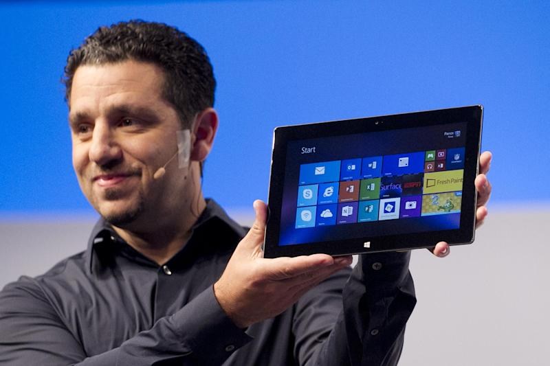 Panos Panay, corporate vice president of Microsoft, introduces a new Surface tablet, Monday, Sept. 23, 2013 in New York. Microsoft is introducing new Surface tablet computers and accessories, including a professional model that allows people to use it more like a laptop or a desktop. (AP Photo/Mark Lennihan)