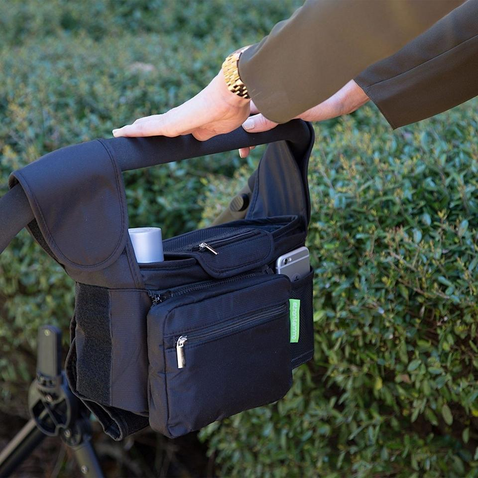 """You can neatly fill this with water bottles, first aid supplies, diapers ... or cellphones, tablets and anything else you need to get through a day at the park with a baby.<br /><br /><strong>Promising review:</strong>""""This stroller organizer is awesome! It is well-made, highly versatile/adjustable, and it allows me to go purse and diaper bag free! There is a removable zipper pouch in which one could put in lip balm, personal hygiene, keys, ID, and money. The zipper bag is removable. I love that this folds down and attaches to the frame of stroller.<strong>This compartment is HUGE! The mesh material makes it a breeze to clean and also allows one to see where things are</strong>, as big compartments can make it difficult to find things. My laptop/tablet fits perfectly. I have plenty of room for a bluetooth speaker, sunscreen, diapers, wipes, etc. Seriously, this replaces all of my bags. This works great!"""" —<a href=""""https://amzn.to/2OQZJmr"""" target=""""_blank"""" rel=""""nofollow noopener noreferrer"""" data-skimlinks-tracking=""""5902331"""" data-vars-affiliate=""""Amazon"""" data-vars-href=""""https://www.amazon.com/gp/profile/amzn1.account.AETA3533SKEUG5G6NWPUSV3SRLWA?tag=bfmal-20&ascsubtag=5902331%2C30%2C37%2Cmobile_web%2C0%2C0%2C16540685"""" data-vars-keywords=""""cleaning"""" data-vars-link-id=""""16540685"""" data-vars-price="""""""" data-vars-product-id=""""16069657"""" data-vars-retailers=""""Amazon"""">christina pitchford<br /><br /></a><strong>Get it from Amazon for<a href=""""https://amzn.to/3uRctJa"""" target=""""_blank"""" rel=""""nofollow noopener noreferrer"""" data-skimlinks-tracking=""""5902331"""" data-vars-affiliate=""""Amazon"""" data-vars-asin=""""B00KLO5F78"""" data-vars-href=""""https://www.amazon.com/dp/B00KLO5F78?tag=bfmal-20&ascsubtag=5902331%2C30%2C37%2Cmobile_web%2C0%2C0%2C16540683"""" data-vars-keywords=""""cleaning"""" data-vars-link-id=""""16540683"""" data-vars-price="""""""" data-vars-product-id=""""18115105"""" data-vars-product-img=""""https://m.media-amazon.com/images/I/519H1P8mlnL.jpg"""" data-vars-product-title=""""Ethan & Emma Universal Baby Stroller Organizer w"""