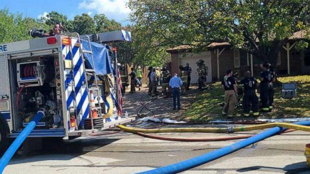 PHOTO: First responders are seen near the site where a military training aircraft crashed into a residential neighborhood in Lake Worth, Texas, Sept. 19, 2021. (Joni Scarbrough via Reuters)