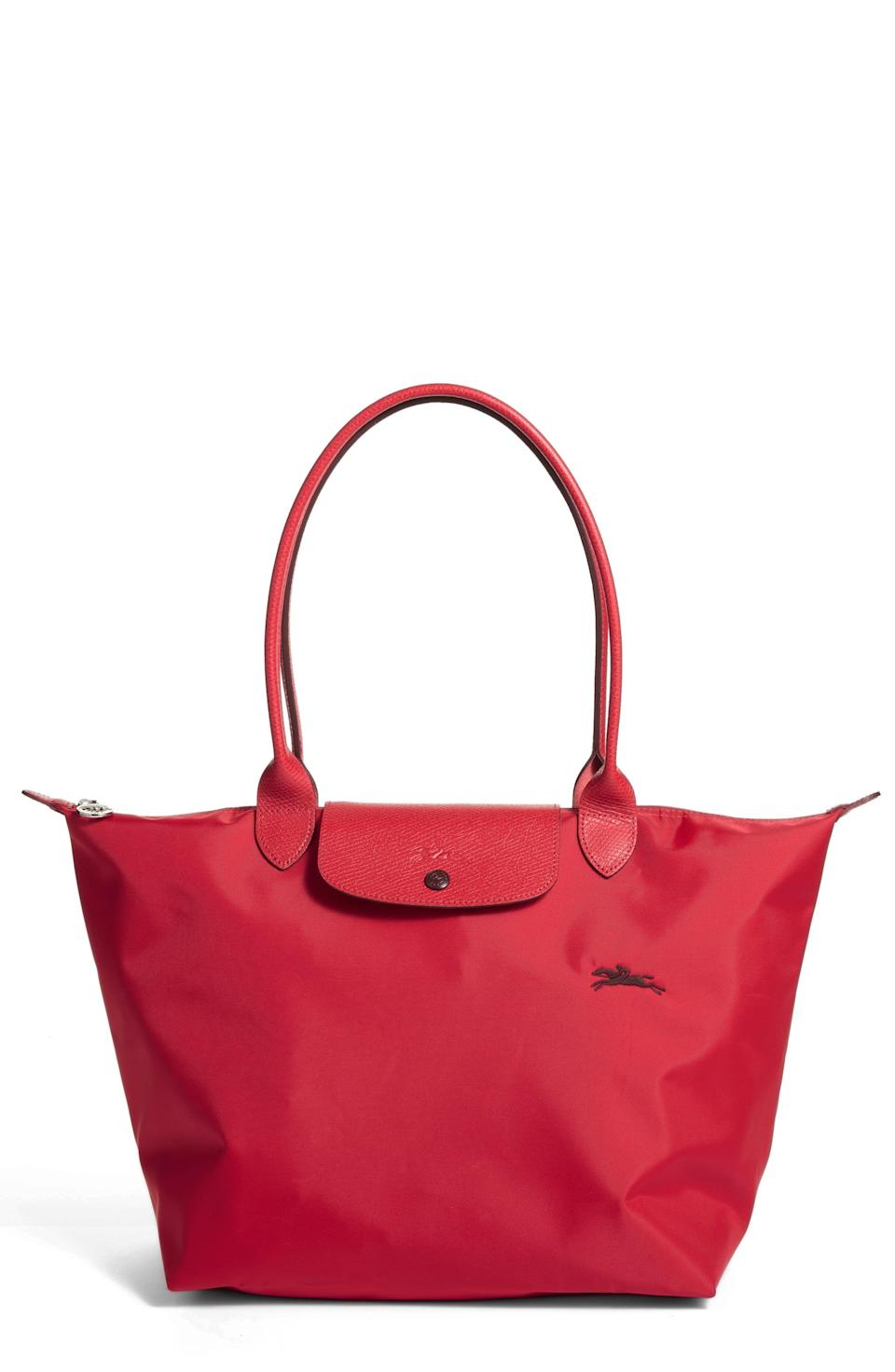 """<p><strong>LONGCHAMP</strong></p><p>nordstrom.com</p><p><a href=""""https://go.redirectingat.com?id=74968X1596630&url=https%3A%2F%2Fwww.nordstrom.com%2Fs%2Flongchamp-le-pliage-club-tote%2F6111365&sref=https%3A%2F%2Fwww.townandcountrymag.com%2Fstyle%2Ffashion-trends%2Fg36557314%2Fnordstrom-half-yearly-sale-may-2021%2F"""" rel=""""nofollow noopener"""" target=""""_blank"""" data-ylk=""""slk:Shop Now"""" class=""""link rapid-noclick-resp"""">Shop Now</a></p><p>$124</p><p><em>Original Price: $155</em></p>"""