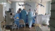 Doctors and nurses perform a surgery at a hospital in Blagoveshchensk