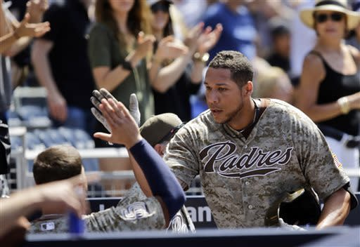 San Diego Padres' Kyle Blanks is congratulated after his solo home run in the fifth inning against the Washington Nationals during a baseball game in San Diego, Sunday, May 19, 2013. (AP Photo/Lenny Ignelzi)