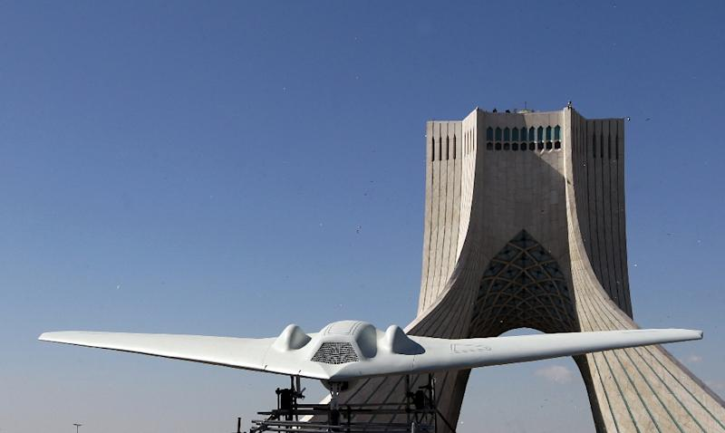 A stealthy RQ-170 Sentinel (pictured on display in Tehran) was lost over Iran in 2011, with Tehran claiming to have used it to build a copy of its own (AFP Photo/ATTA KENARE)
