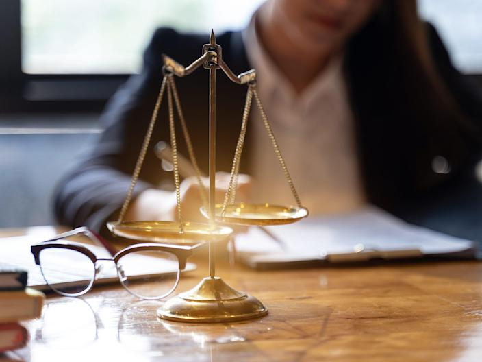 Midsection Of Lawyer Working At Desk In Courtroom