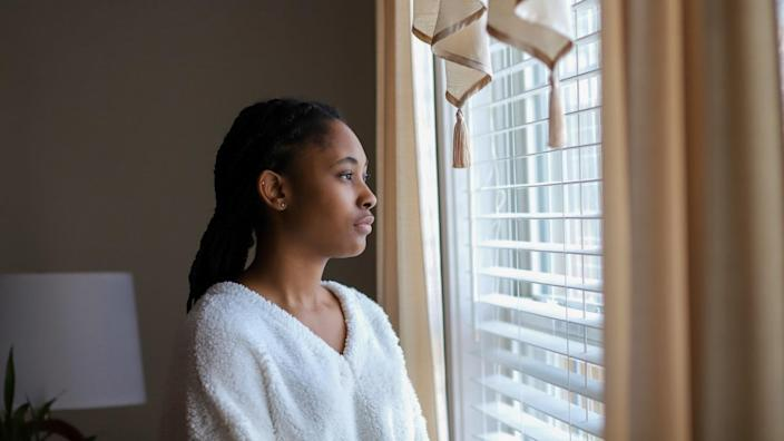 African-American teenaged girl sad and lonely.
