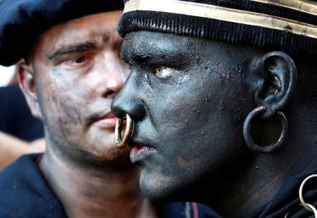 """The Savage"", a white performer in a blackface disguise, takes part in the festival Ducasse d'Ath in Ath"