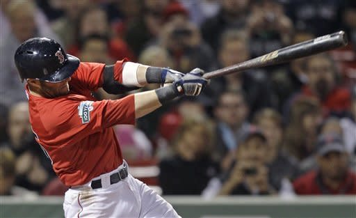 Boston Red Sox's Dustin Pedroia follows through on a single in the seventh inning inning of a baseball game against the Cleveland Indians at Fenway Park in Boston, Friday, May 11, 2012. (AP Photo/Charles Krupa)