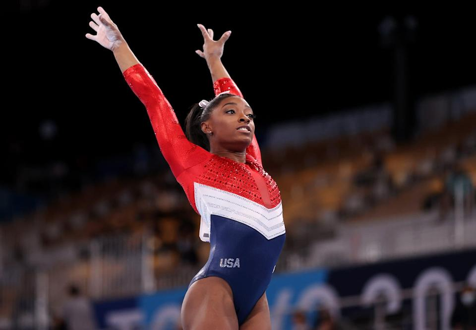 TOKYO, JAPAN - JULY 27: Simone Biles of Team United States competes on vault during the Women's Team Final on day four of the Tokyo 2020 Olympic Games at Ariake Gymnastics Centre on July 27, 2021 in Tokyo, Japan. (Photo by Laurence Griffiths/Getty Images)