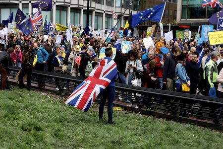 EU supporters, calling on the government to give Britons a vote on the final Brexit deal, participate in the 'People's Vote' march in central London, Britain March 23, 2019. REUTERS/Kevin Coombs