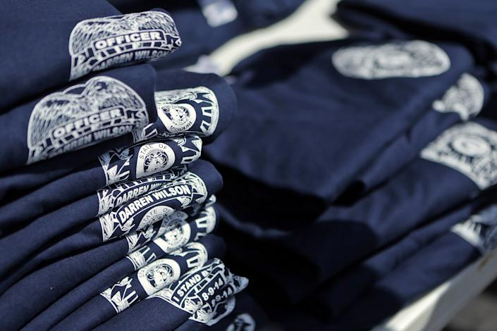 """Supporters have sold """"Officer Darren Wilson. I stand by you"""" T-shirts to help the patrolman with legal expenses. (AP Photo/St. Louis Post-Dispatch, Huy Mach)"""