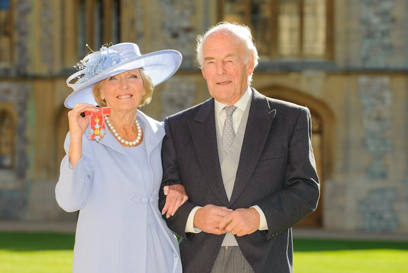WINDSOR, ENGLAND - OCTOBER 12: Mary Berry, poses with her husband Paul Hunnings, after becoming a Commander of the British Empire (CBE) from the Prince of Wales during an Investiture ceremony at Windsor Castle on October 12, 2012 in Windsor, England. (Photo by Dominic Lipinski-WPA Pool/Getty Images)