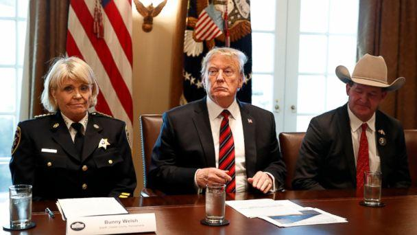 President Donald Trump, with Carolyn 'Bunny' Welsh, sheriff of Chester County, Pa., left, and AJ Louderback, sheriff of Jackson County, Texas, attends a roundtable discussion on border security with local leaders, Friday Jan. 11, 2019. (The Associated Press)