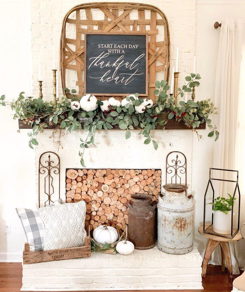 """<p>This tutorial will show you how to create a beautiful layered garland for your mantel. </p><p><strong>Get the tutorial at <a href=""""https://blessthisnestblog.com/farmhouse-style-fall-mantel-and-diy-garland/"""" rel=""""nofollow noopener"""" target=""""_blank"""" data-ylk=""""slk:Bless This Nest"""" class=""""link rapid-noclick-resp"""">Bless This Nest</a>.</strong></p><p><a class=""""link rapid-noclick-resp"""" href=""""https://go.redirectingat.com?id=74968X1596630&url=https%3A%2F%2Fwww.walmart.com%2Fip%2FCoolmade-5-5Ft-Seeded-Eucalyptus-Garland-Artificial-Vines-Faux-Leaves-Table-Garland-Greenery-Wedding-Backdrop-Arch-Wall-Decor%2F649160044&sref=https%3A%2F%2Fwww.thepioneerwoman.com%2Fhome-lifestyle%2Fcrafts-diy%2Fg36891743%2Ffall-mantel-decorations%2F"""" rel=""""nofollow noopener"""" target=""""_blank"""" data-ylk=""""slk:SHOP GARLANDS"""">SHOP GARLANDS</a></p>"""
