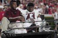 South Carolina linebacker Sherrod Greene (44) is taken off the field on a cart after an injury during the team's NCAA college football game against Georgia on Saturday, Sept. 18, 2021, in Athens, Ga. (Joshua Boucher/The State via AP)
