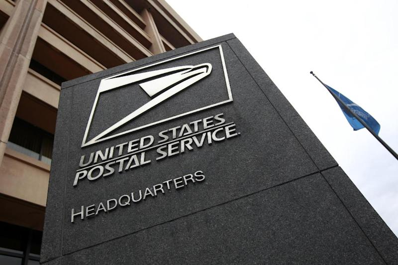FILE This Dec. 5, 2011 file photo shows the United States Postal Service headquarters in Washington. The nearly bankrupt U.S. Postal Service on Thursday reported losses of $57 million per day in the last quarter and warned it will miss another payment due to the U.S. Treasury, just one week after its first-ever default on a payment for future retiree health benefits. (AP Photo/Charles Dharapak, File)