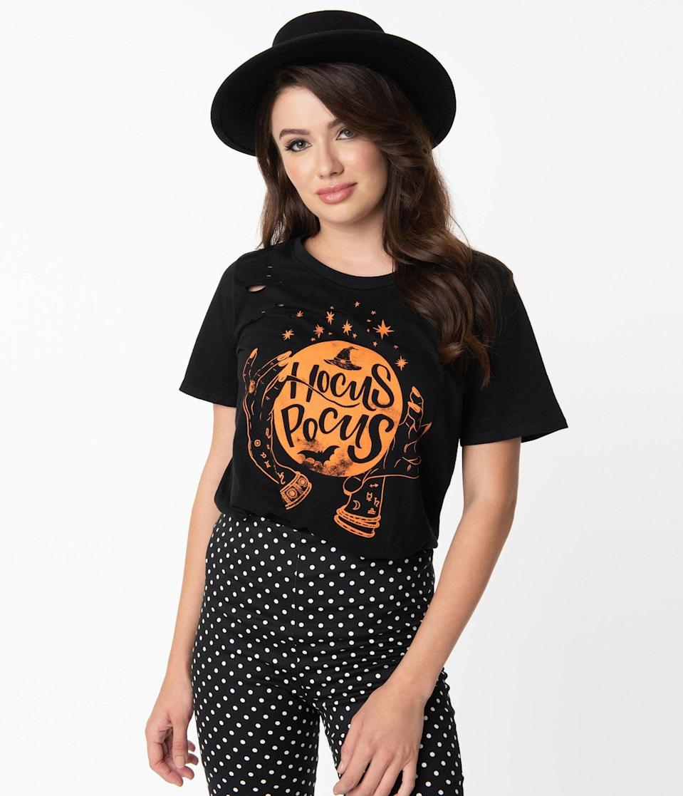 <p>You'll put a spell on anyone who looks at this <span>Black and Orange Hocus Pocus Distressed Tee</span> ($30). </p>
