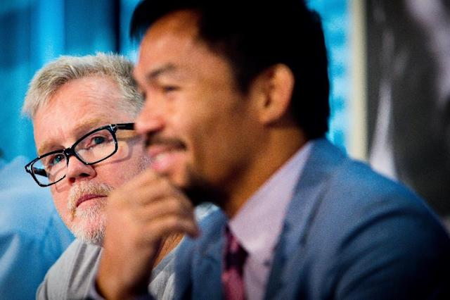 Filipino star Manny Pacquiao admits he has not spoken with former trainer Freddie Roach about a possible reunion (AFP Photo/Patrick HAMILTON)