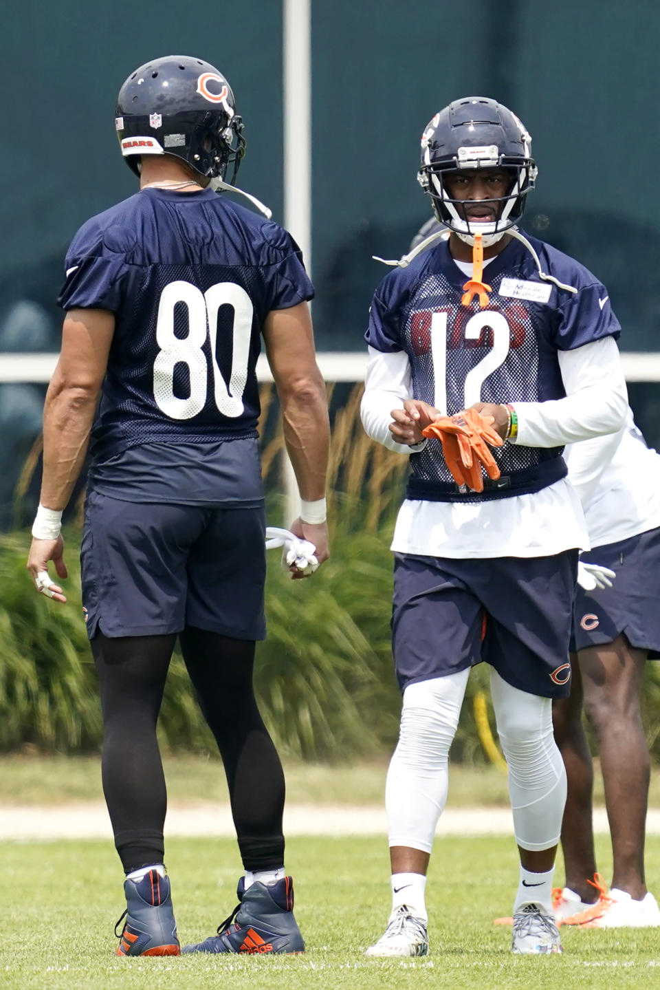 Chicago Bears wide receiver Allen Robinson II, right, talks with tight end Jimmy Graham during NFL football practice in Lake Forest, Ill., Wednesday, July 28, 2021. (AP Photo/Nam Y. Huh)