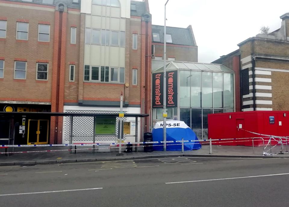 Police cordoned off a block of shops on Woolwich New Road (PA Wire)