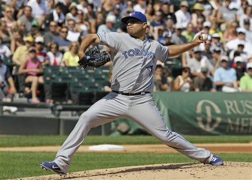 Toronto Blue Jays starter Ricky Romero throws to a Chicago White Sox batter during the first inning of a baseball game in Chicago, Saturday, July 7, 2012. (AP Photo/Nam Y. Huh)