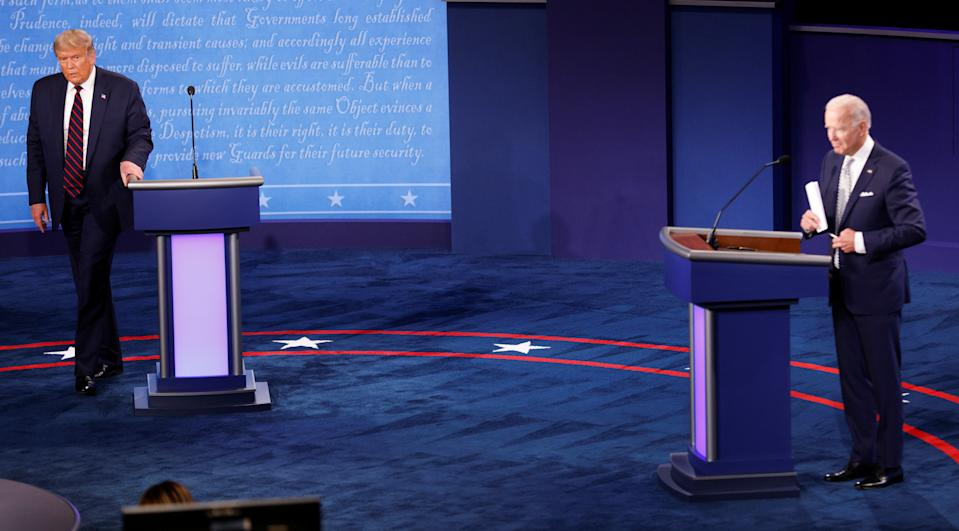 U.S. President Donald Trump and Democratic presidential nominee Joe Biden are seen on stage after the first 2020 presidential campaign debate held on the campus of the Cleveland Clinic at Case Western Reserve University in Cleveland, Ohio, U.S., September 29, 2020. REUTERS/Brian Snyder