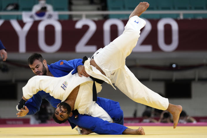 Victor Sterpu of Moldova, top, and Tohar Butbul of Israel compete during their men's -73kg round of 16 judo match at the 2020 Summer Olympics in Tokyo, Japan, Monday, July 26, 2021. (AP Photo/Vincent Thian)