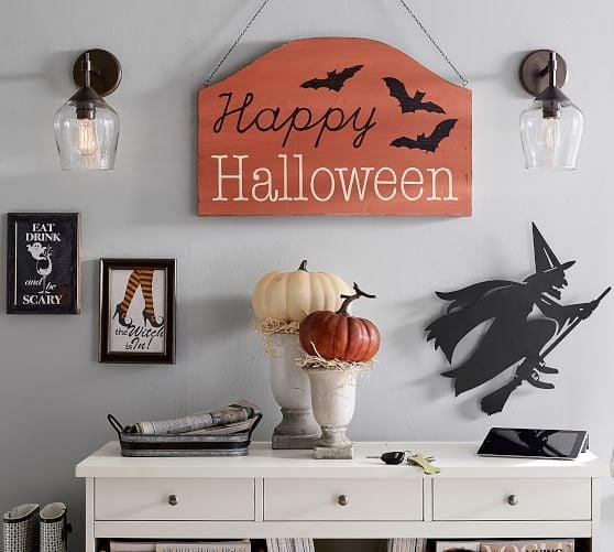 <p>Decorate your walls with this bewitching <span>The Witch Is In</span> ($99) framed wall art. </p>