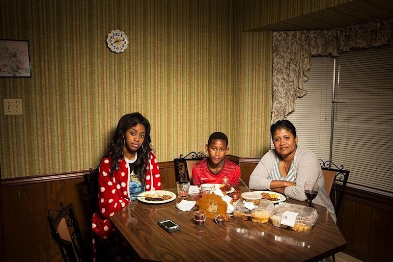 Seynabou, Rui James and Marie eat dinner in Louisiana. (LOIS BIELEFELD)