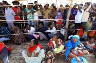 FILE PHOTO: Ethiopians receive supplies at the Um-Rakoba camp on the Sudan-Ethiopia border