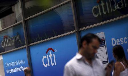 People walk by a Citibank branch in Buenos Aires
