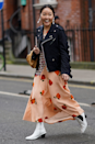"""<p>Take your printed <a href=""""https://www.cosmopolitan.com/uk/fashion/style/a36416460/black-midi-dress-new-look/"""" rel=""""nofollow noopener"""" target=""""_blank"""" data-ylk=""""slk:midi dress"""" class=""""link rapid-noclick-resp"""">midi dress</a> from zero to hero by slipping on a pair of white booties on your way out the door, et voila - you're a fashion force to be reckoned with.</p>"""