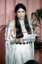 """<p>Brando went from looking dapper on the occasion of his Oscar win in 1955 for <i>On the Waterfront</i>, to staying home and dispatching actress Sacheen Littlefeather to reject his <i>Godfather</i> statuette in protest of """"the treatment of American Indians today by the film industry.""""</p><p>(Sacheen Littlefeather; photo: Getty Images)</p>"""