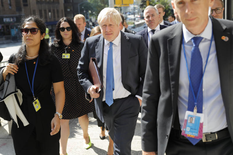 Britain's Prime Minister Boris Johnson walks down the street near United Nations headquarters in New York, Monday, Sept. 23, 2019. (AP Photo/Seth Wenig)