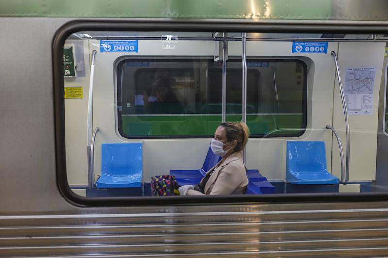 SAO PAULO, March 22, 2020 -- A woman wears a face mask inside a subway train in Sao Paulo, Brazil, March 22, 2020. Many countries in Latin America have imposed quarantines to stop the COVID-19 spread, as more and more confirmed cases were reported. In Brazil, one of the hardest-hit countries in the region, the number of cases rose to 1,128 on Saturday, with 18 deaths. In the 26 Brazilian states hit by the virus, Sao Paulo, the worst-hit one, has confirmed 459 cases and 15 deaths. As a result, authorities on March 21 ordered a quarantine and a halt to most economic activities for 15 days. (Photo by Rahel Patrasso/Xinhua via Getty) (Xinhua/La Heer·patelasuo via Getty Images)