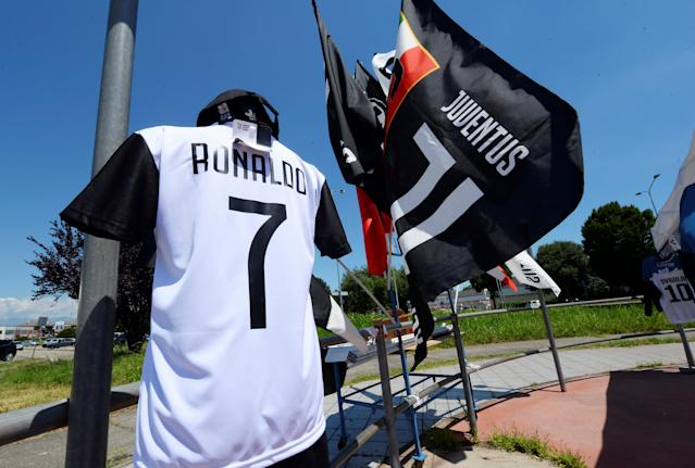 A Juventus' jersey with the name of Cristiano Ronaldo is exhibited in a shop in Turin, Italy July 7, 2018. REUTERS/Massimo Pinca