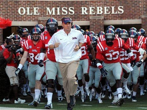 Mississippi coach Hugh Freeze leads the team on the field at an NCAA college football game against UTEP Saturday, Sept. 8, 2012, in Oxford, Miss. (AP Photo/The Oxford Eagle, Bruce Newman)