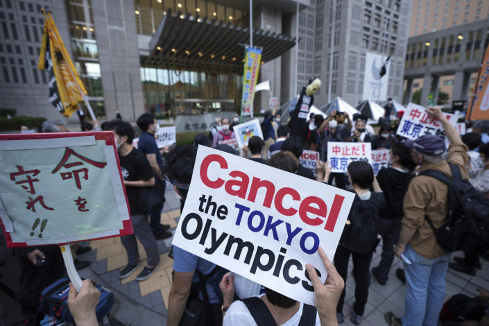 FILE - In this June 23, 2021, file photo, people against the July opening of the Tokyo 2020 Olympics, gather to protest around the Tokyo Metropolitan Government building during a demonstration in Tokyo. From doping, to demonstrations to dirty officials, the Olympics have never lacked their share of off-the-field scandals and controversies that keep the Games in the headlines long after the torch goes out. (AP Photo/Eugene Hoshiko, File)