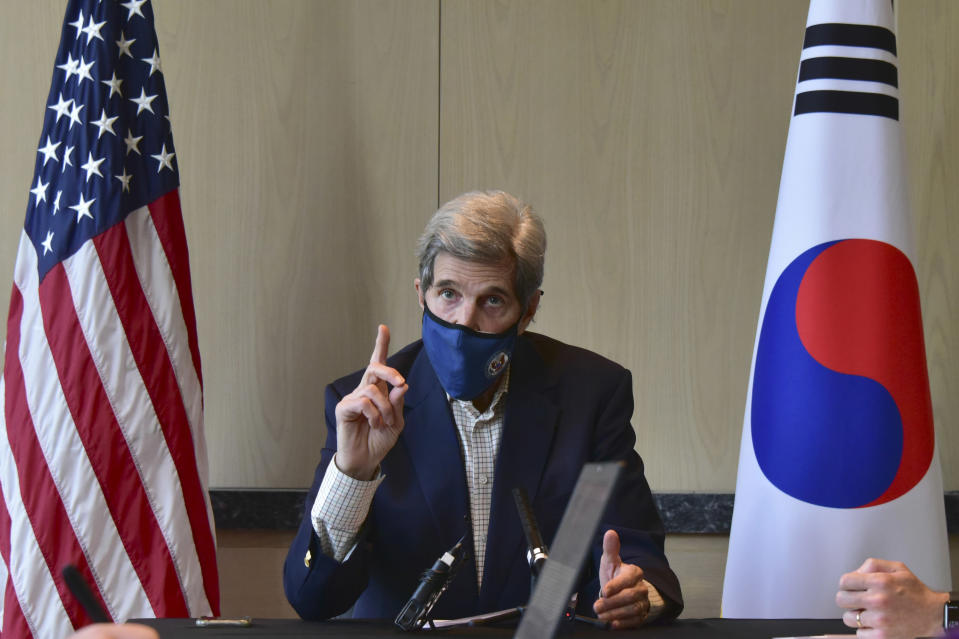 In this photo provided by U.S. Embassy Seoul, U.S. special envoy for climate John Kerry speaks during a round table meeting with the media in Seoul, South Korea, Sunday, April 18, 2021. The United States and China, the world's two biggest carbon polluters, have agreed to cooperate with other countries to curb climate change, just days before U.S. President Joe Biden hosts a virtual summit of world leaders to discuss the issue. (U.S. Embassy Seoul via AP)