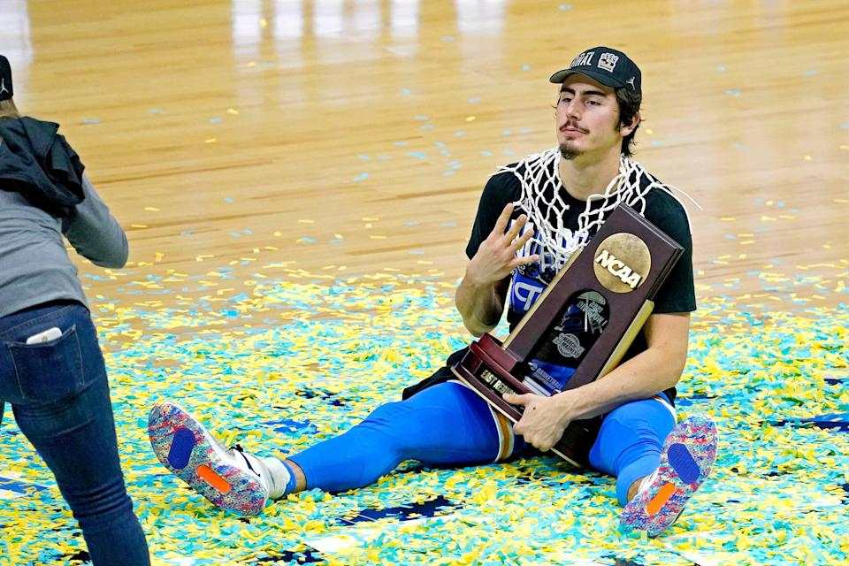 UCLA Bruins guard Jaime Jaquez Jr. (4) pose for a picture after the UCLA Bruins beat the Michigan Wolverines in the Elite Eight of the 2021 NCAA Tournament at Lucas Oil Stadium.