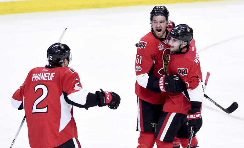 Ottawa Senators defenceman Chris Wideman (6) celebrates his goal with teammates Dion Phaneuf (2) and Mark Stone (61) during third period of game two NHL Stanley Cup hockey playoff action against the Boston Bruins, in Ottawa, Saturday, April 15, 2017. (Sean Kilpatrick/The Canadian Press via AP)