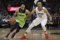 Minnesota Timberwolves' Jordan McLaughlin (6) drives the ball around Los Angeles Clippers' Landry Shamet in the first half of an NBA basketball game Saturday, Feb. 8, 2020, in Minneapolis. (AP Photo/Stacy Bengs)