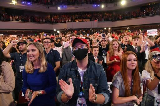 Supporters listen as US President Donald Trump speaks during a Students for Trump event at a mega church in Phoenix, Arizona in June; mask wearing and social distancing are ideas that have been scorned by many on the political right in the US