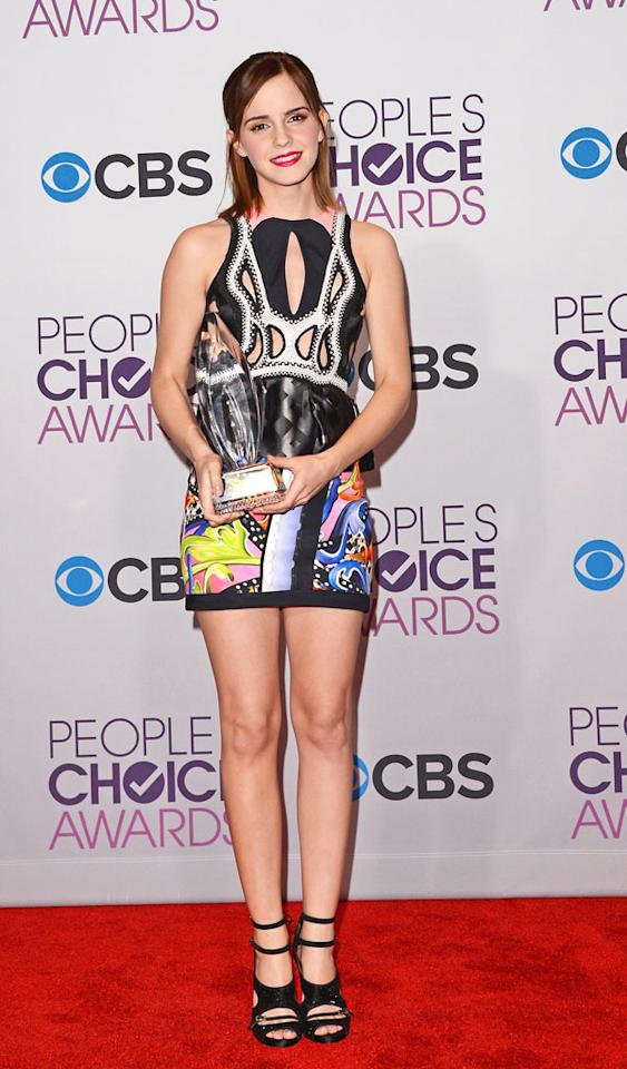"LOS ANGELES, CA - JANUARY 09:  Actress Emma Watson poses with Favorite Drama Movie award for ""The Perks of Being a Wallflower"" in the press room at the 39th Annual People's Choice Awards at Nokia Theatre L.A. Live on January 9, 2013 in Los Angeles, California.  (Photo by Jason Merritt/Getty Images)"
