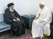 Pope Francis, right, meets with Iraq's leading Shiite cleric, Grand Ayatollah Ali al-Sistani in Najaf, Iraq, Saturday, March 6, 2021. The closed-door meeting was expected to touch on issues plaguing Iraq's Christian minority. Al-Sistani is a deeply revered figure in Shiite-majority Iraq and and his opinions on religious matters are sought by Shiites worldwide. (AP Photo/Vatican Media)