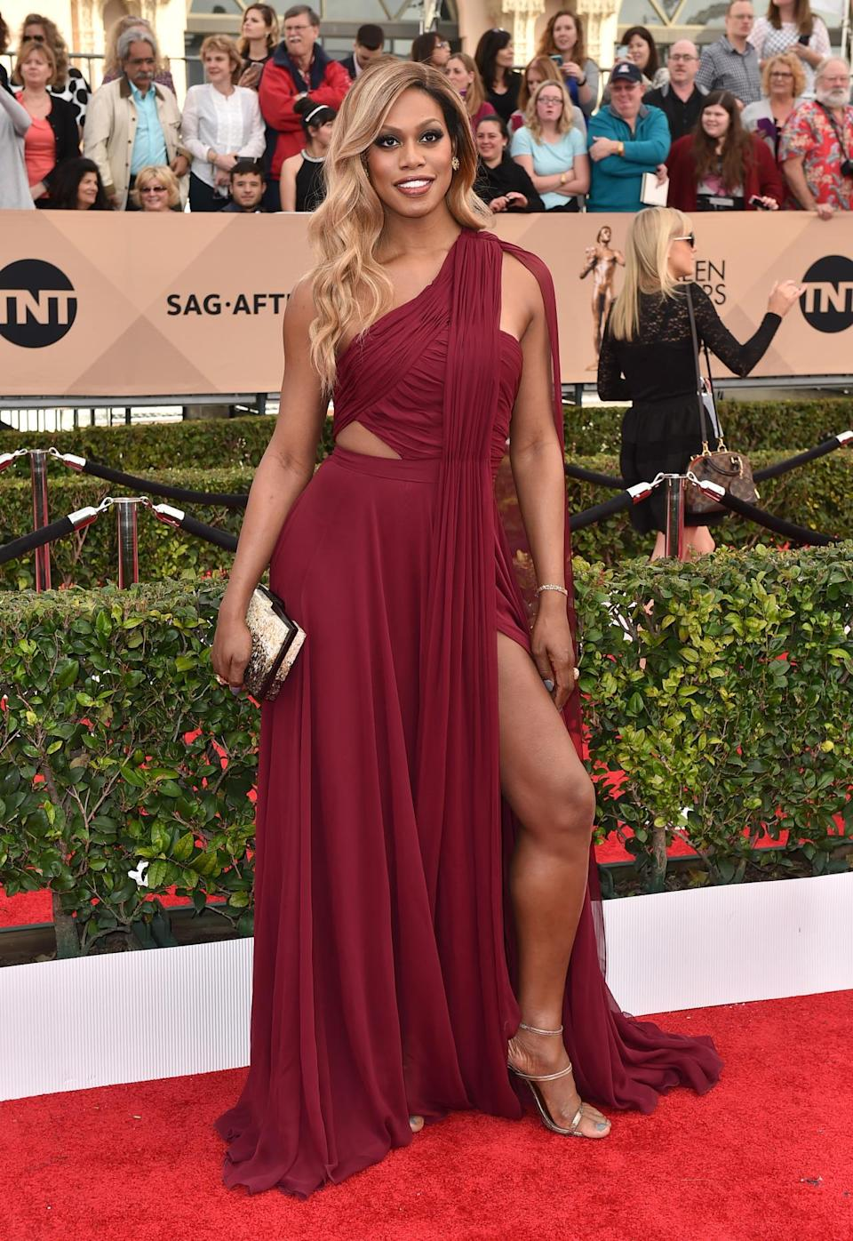 <p>Nominated with cast of the <i>Orange Is the New Black, </i>Laverne Cox attended the SAG Awards in a burgundy gown with cutouts and dramatic draping. Speaking of dramatic, she took the time to get political on the red carpet and gave a shoutout to the people of Flint, Michigan, also calling for the town's governor to resign. <i>Photo: AP</i></p>