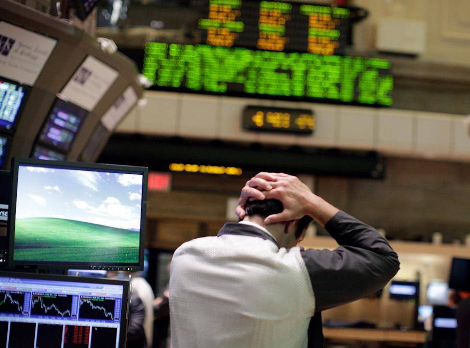 A trader works on the floor of the New York Stock Exchange August 4, 2011. Investors fled Wall Street in   the worst stock-market selloff since the depths of the Great   Recession in early 2009 in what has turned into a full-fledged   correction.     REUTERS/Brendan McDermid (UNITED STATES - Tags: BUSINESS IMAGES OF THE DAY)