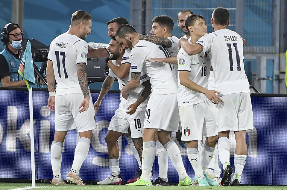 Italian players celebrate scoring their side's third goal during the Euro 2020 soccer championship group A match between Turkey and Italy at the Olympic stadium in Rome, Friday, June 11, 2021. (Ettore Ferrari/Pool via AP)
