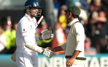 James Anderson shakes hands with Ricky Ponting at the end of play