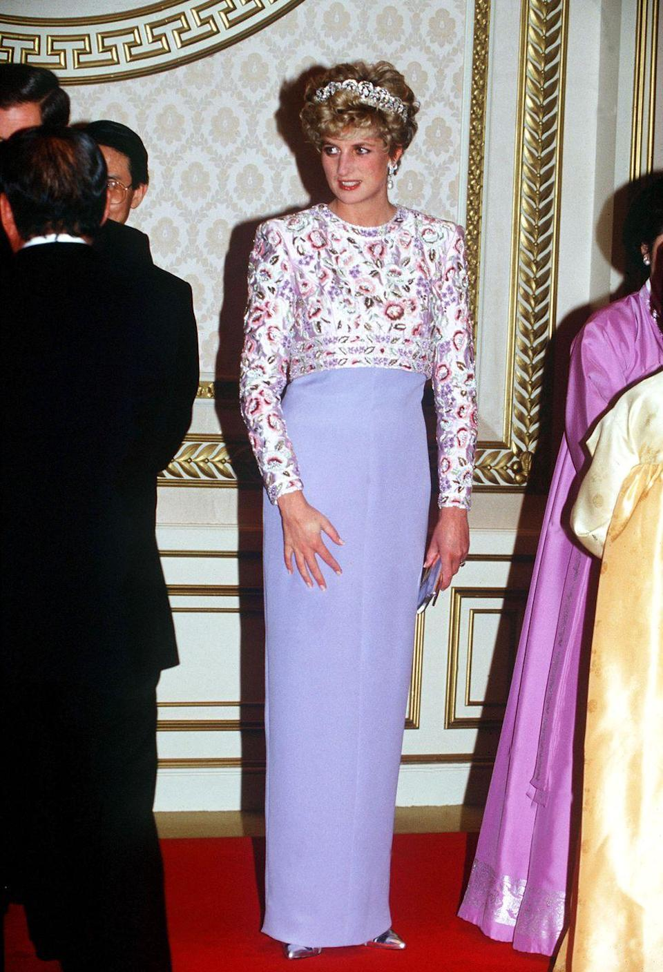 <p>Princess Diana wore her family's Spencer tiara with an elegant Catherine Walker evening gown in 1992. The Princess of Wales wore the floral embroidered bodice and crepe sheath skirt to a banquet in Seoul, South Korea. </p>